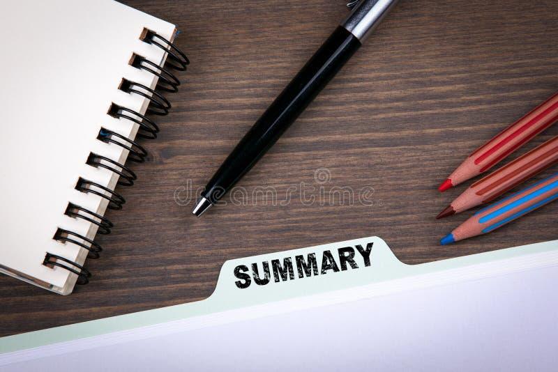 Summary Concept. Folder Register on a dark wooden desk royalty free stock photography