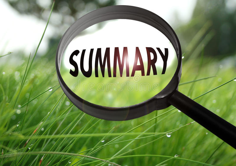 Summary. Magnifying glass with the word summary on grass background. Selective focus royalty free stock photos