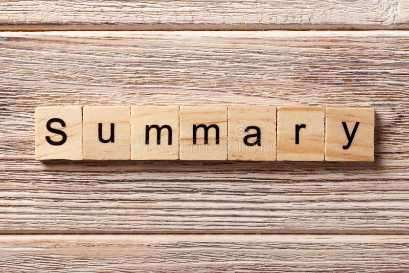 Summary word written on wood block. Summary text on table, concept.  royalty free stock image