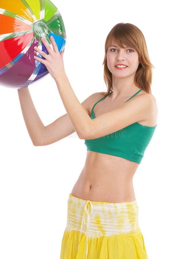 Summer. Young woman in summer outfit plays with a ball stock photo