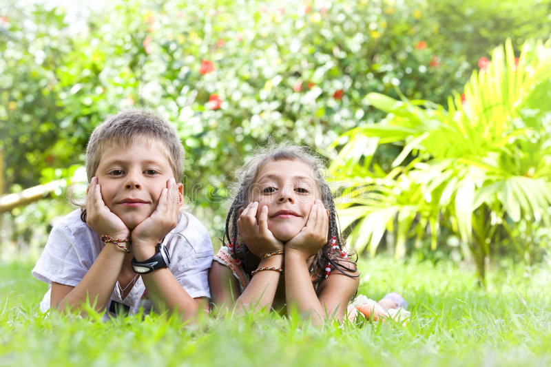While summer. Portrait of little kids having good time in summer environment royalty free stock images