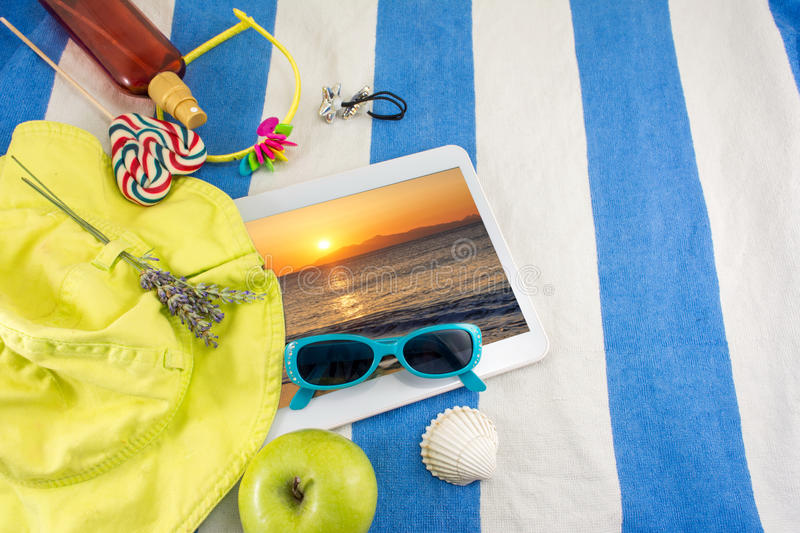 Summer accessories on beach towel. Top view royalty free stock photography