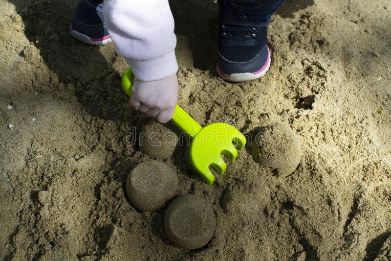 Summer active children`s games in the sandbox stock image
