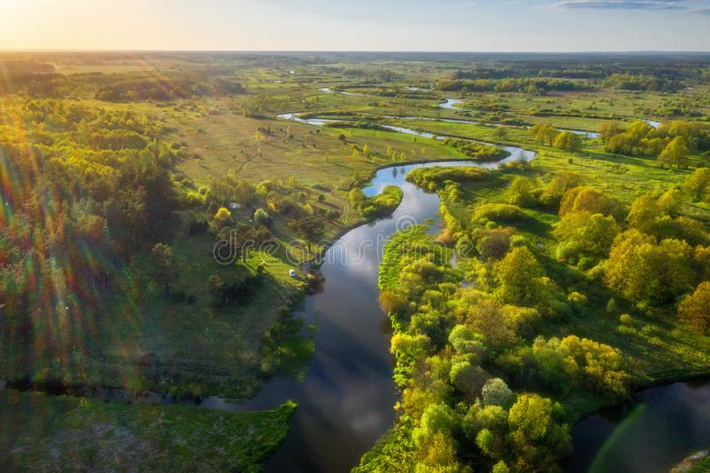 Summer aerial background. Amazing summer nature landscape at sunset from above. Summer river. Scene in the sunny evening stock photos