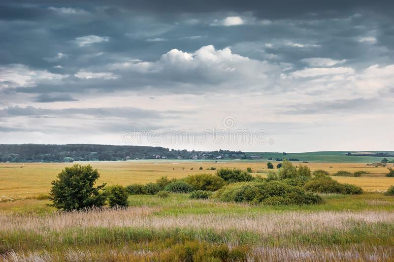 Summer or autumn landscape with thunderclouds, open countryside. _ royalty free stock photography