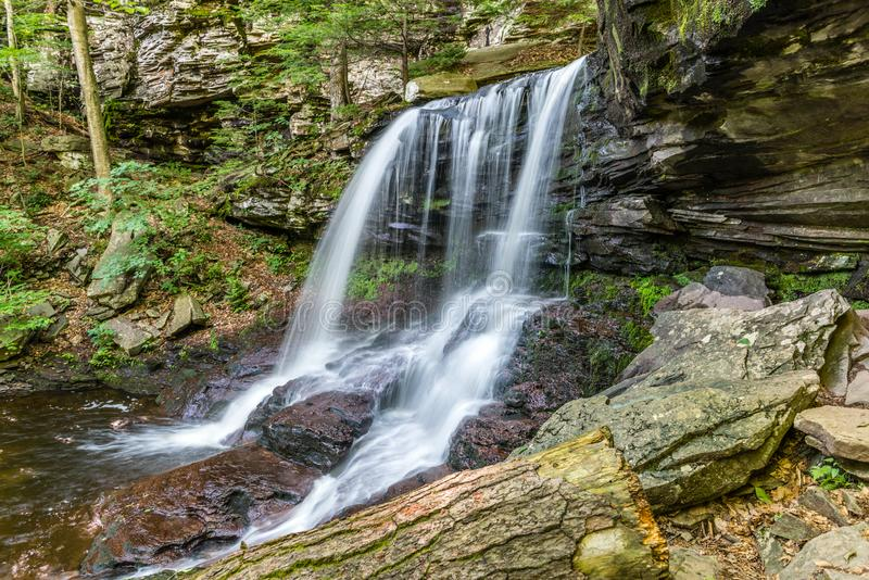 Summer at B. Reynolds Falls in Ricketts Glen State Park of Pennsylvania. The waters of Kitchen Creek flow down shale rock of B. Reynolds Falls in Ricketts Glen stock image