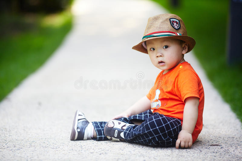 Summer baby boy. Adorable baby boy outdoors at sunny summer day royalty free stock image