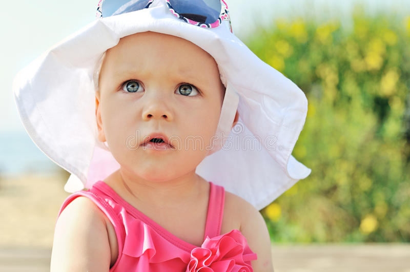 Summer baby. Girl with big hat royalty free stock photo