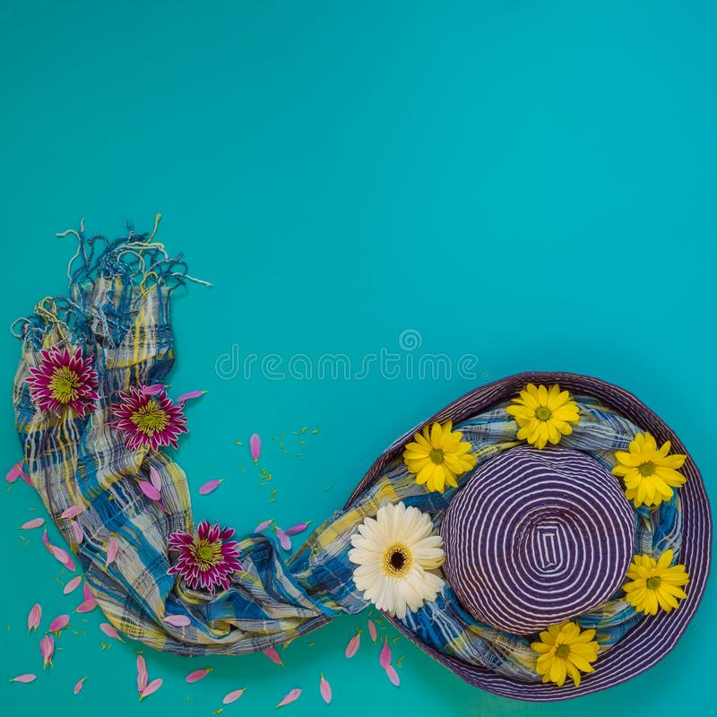Summer background - beach blue hat decorated with white, yellow stock photos