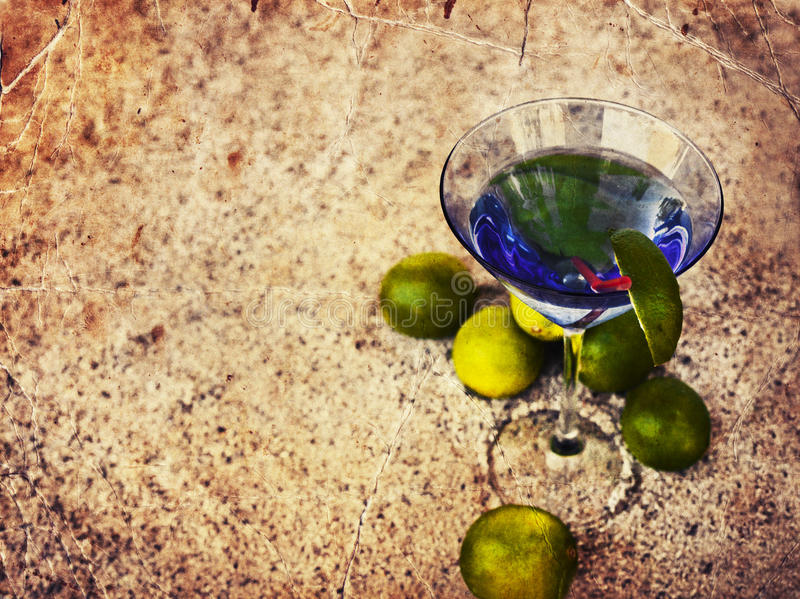 Summer background with cocktail glass and limes royalty free stock photos