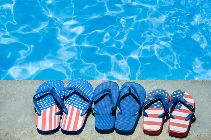Summer background with flip flops near the pool stock photography