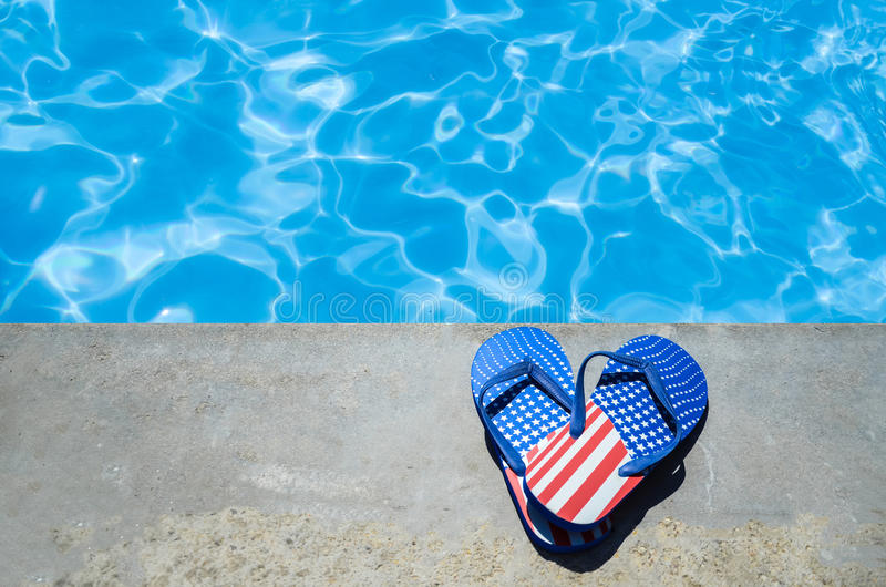 Summer background with heart of flip flops near the pool stock photo
