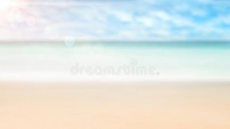 Summer background, nature of tropical golden beach with rays of sun light. Golden sand beach, sea water against blue sky with whit stock photography