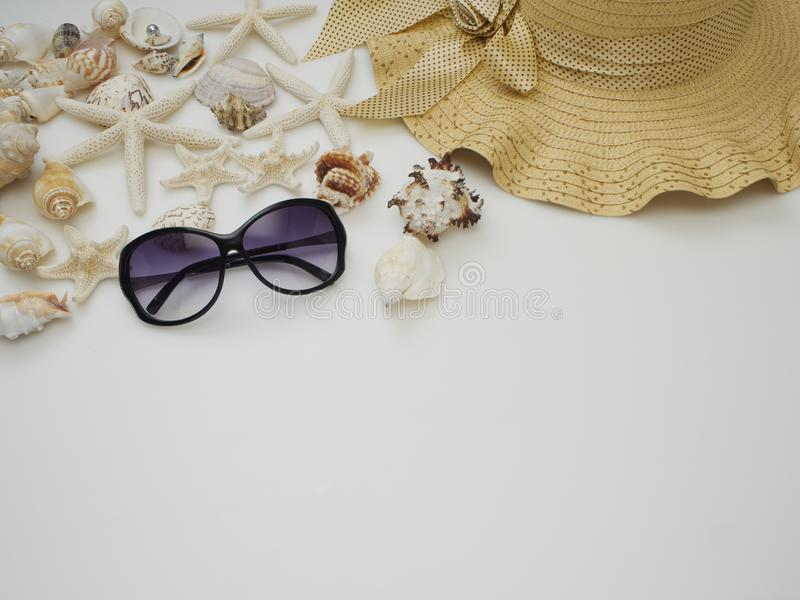 Summer background. Shells, straw hats, sunglasses stock photo