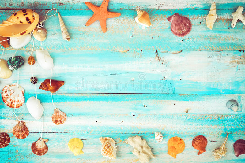 Summer background. Starfish, shells, coral on wood table background. vintage color tone styles stock images