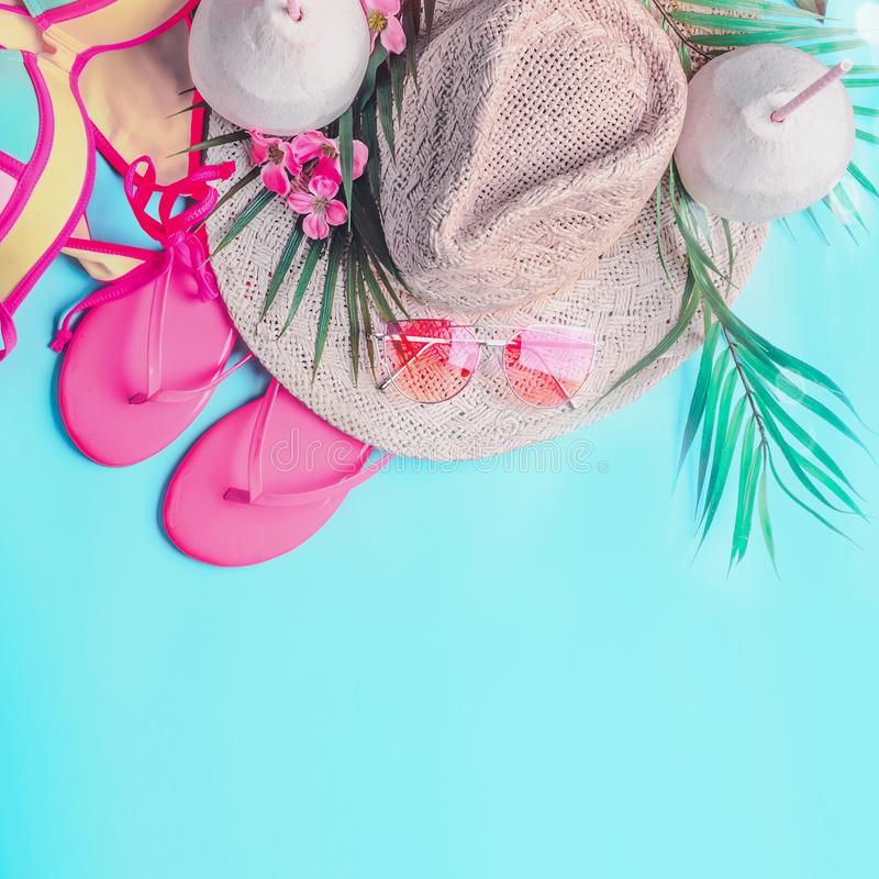 Summer background . Top view of woman`s summer beach accessories: bikini, flip flops, sunglasses, straw hat, palm leaves and stock images