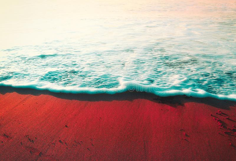 Summer background with wave on the shore sand. And vintage effect stock image