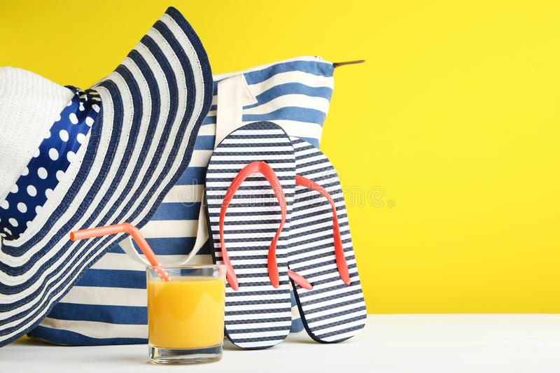 Summer bag with flip flops and juice stock photography
