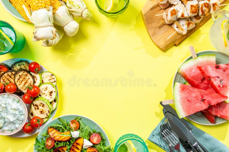 Summer bbq party concept - grilled chicken, vegetables, corn, salad, top view. Copy space stock images