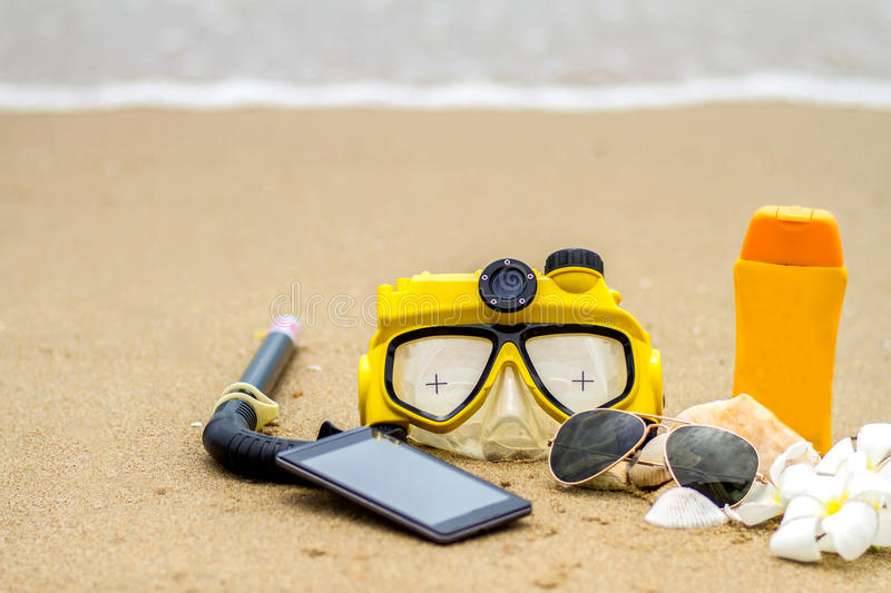 Summer on beach and accessories, sunglasses, sunblock, hat, snorkel, slippers stock photo