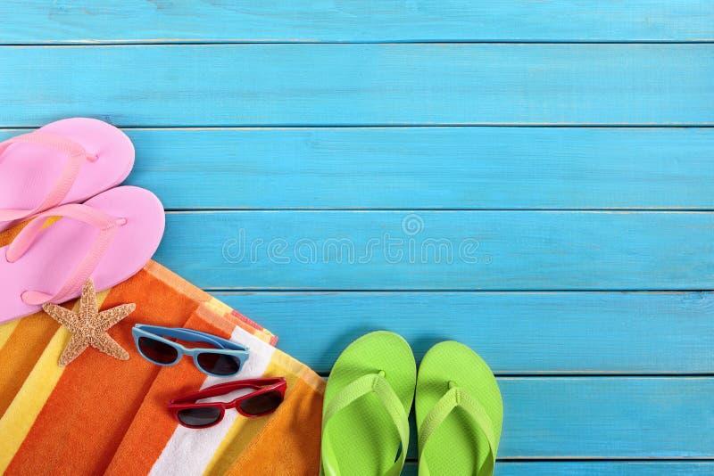 Summer beach background, flip flops, deck, copy space royalty free stock photos