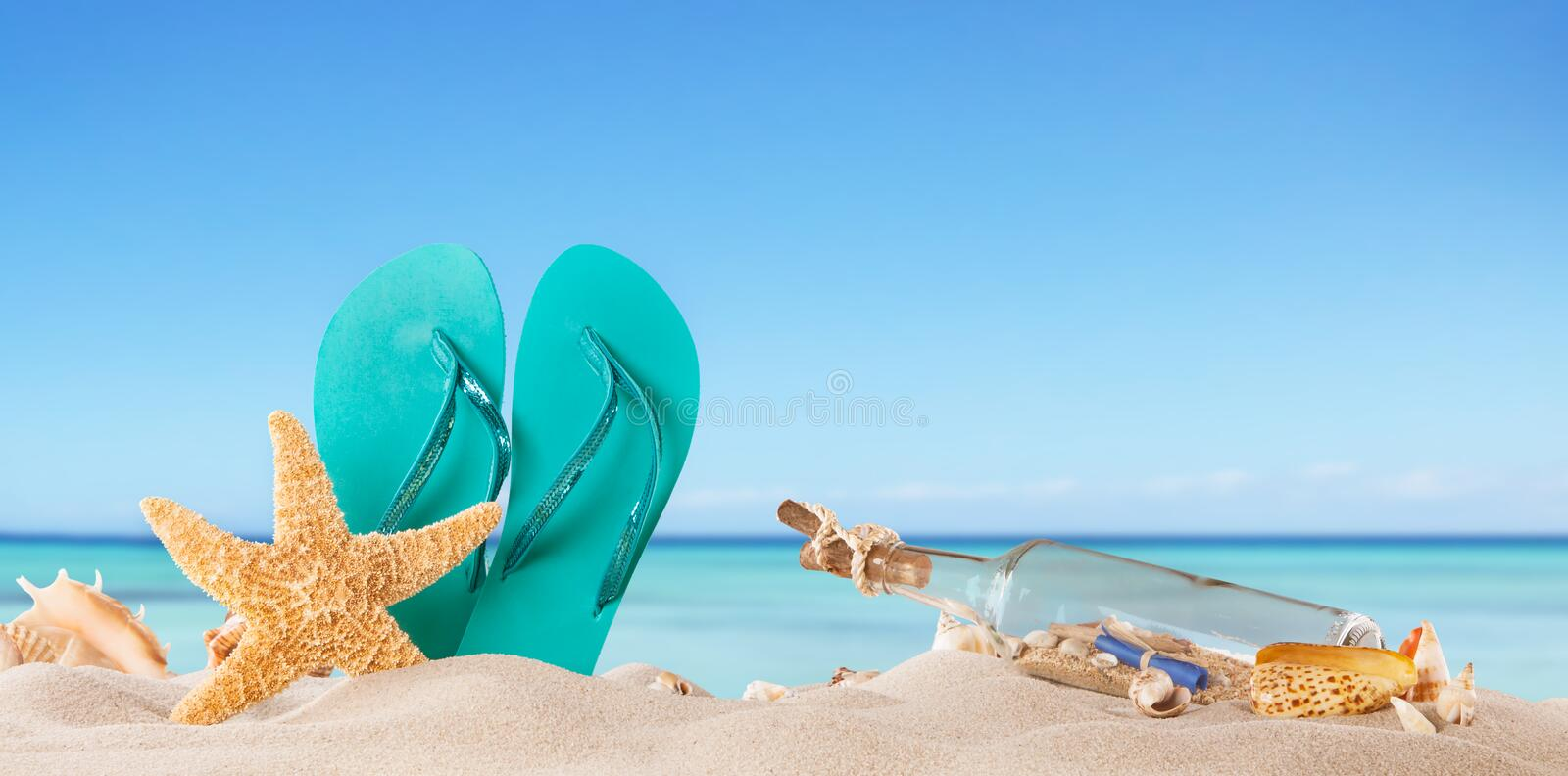 Summer beach. Summer concept with accessories and blur sea on background royalty free stock photography