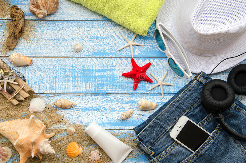 Summer beach concept. Summer accessories on a wooden background stock images