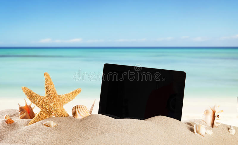 Summer beach. Summer concept with tablet and accessories stock photo