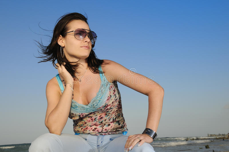 Summer beach fashion. Portrait of young female beauty on tropical beach stock image