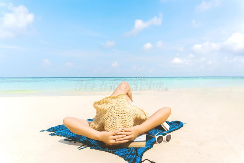 Summer Beach Holiday Woman relax on the beach in free time.  stock photography