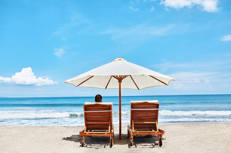 Summer Beach. Holidays Vacations. Woman Relaxing, Deck Chairs. Summer Beach Relaxation On Holidays Vacations. Woman Relaxing On Beach Lounge Chairs Under Tent By stock images