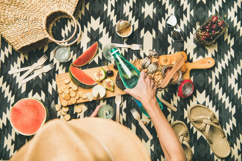 Summer beach picnic setting with charcuterie and fruits, copy space royalty free stock photos