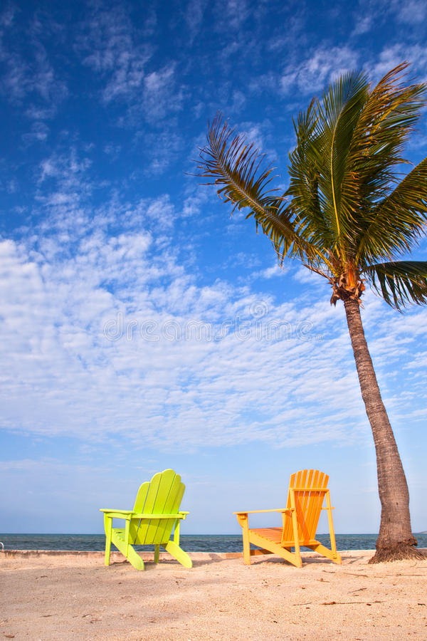 Summer Beach Scene With Palm Trees And Lounge Chairs Stock