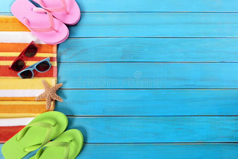Summer beach side border background, sunglasses, flip flops, copy space royalty free stock images