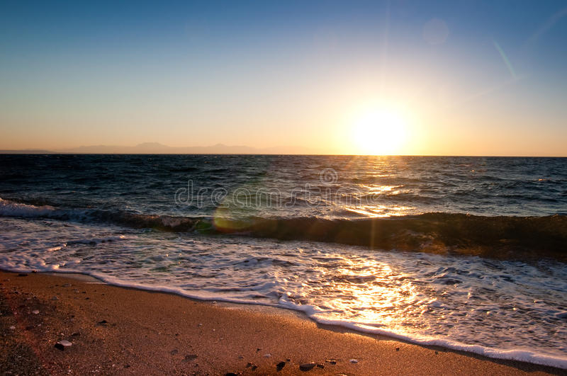 Summer beach sunrise. Sunrise on summer beach with sand and waves royalty free stock images