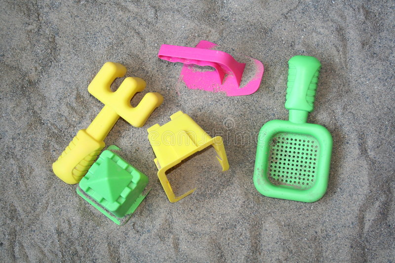 Summer Beach Toys. Plastic summer toys on the beach stock photography
