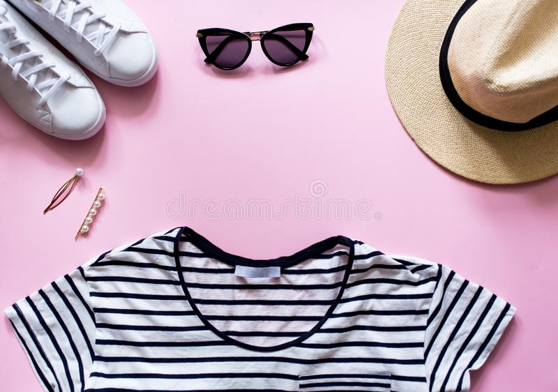 Summer beach travel outfit and accessories. Flatlay of a trendy woman fashion outfit. royalty free stock photos