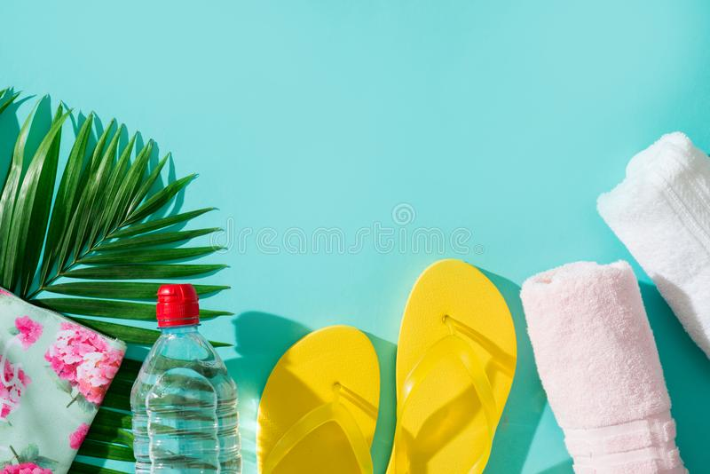 Summer beach vacation and accessories on blue background. Summer beach vacation and accessories on blue background royalty free stock image