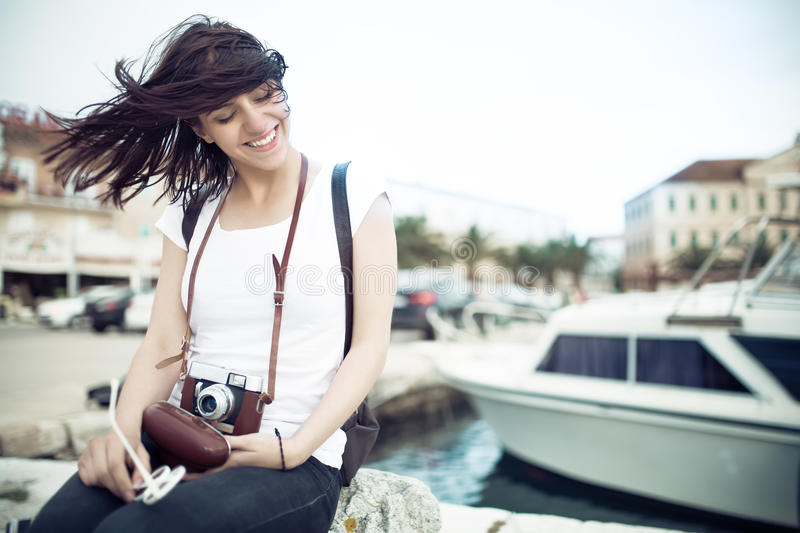 Summer beach woman fun holding vintage retro camera laughing and smiling happy during summer holiday vacation travel stock image