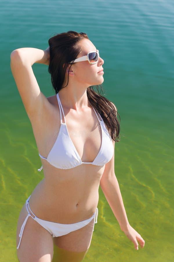 Summer beach young woman in bikini stock photography