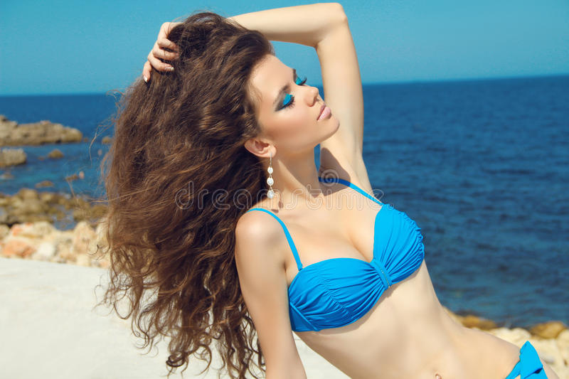Summer beauty girl portrait with long wavy hair & makeup on the stock photo