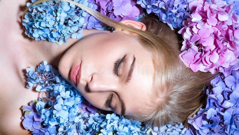 Summer beauty. girl with summer makeup. Makeup cosmetics and skincare. Spring woman with hydrangea flowers. Fashion. Portrait of woman. Healthy hair and skin royalty free stock photography