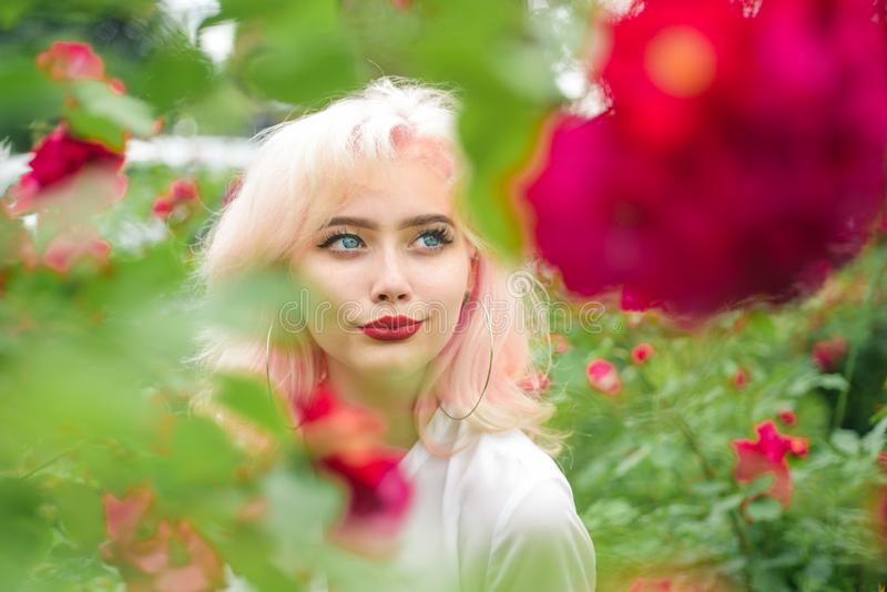 Summer beauty. Makeup cosmetics and skincare. Spring woman with flowers. Fashion portrait of woman. hair coloring. girl royalty free stock photography