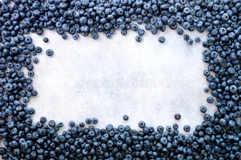 Summer berries background. Top view. Food frame with assorted mix of strawberry, blueberry. Vitamin, vegan, vegetarian. Concept stock photography