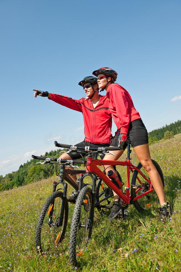 Download Summer Bike - Young Sportive Couple In Meadow Stock Photo - Image: 10842086
