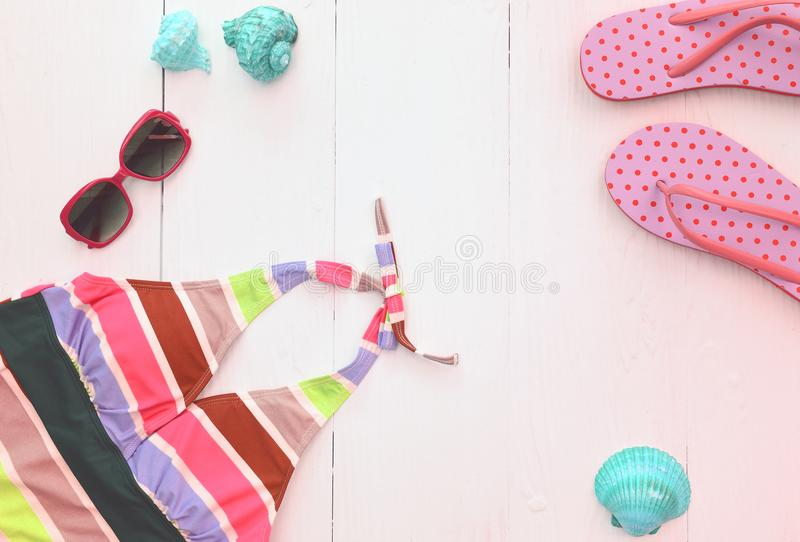 Summer bikini and sunglasses with accessories and sandals stock images
