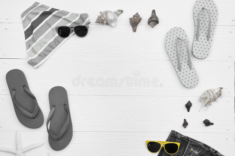Summer bikini and sunglasses with accessories and sandals royalty free stock photography