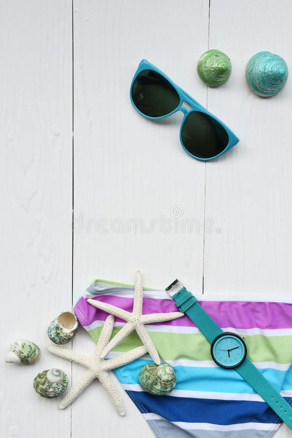 Summer bikini and sunglasses with accessories royalty free stock photos