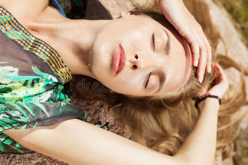 Summer bliss. Beautiful woman relaxing under the sun royalty free stock photos