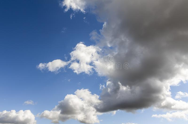 Summer blue sky with rain clouds closeup.  stock photo
